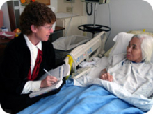 Barbara Esrig with a patient writing